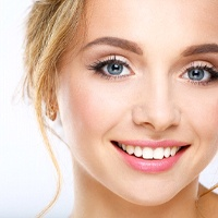 Woman with an attractive smile from cosmetic dentist.