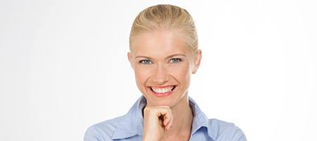 Woman with attractive smile from cosmetic dentist.